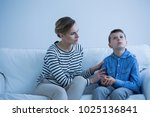 autistic boy sitting on a sofa... | Shutterstock . vector #1025136841