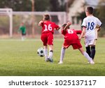 young children players match on ... | Shutterstock . vector #1025137117
