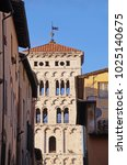 Small photo of Façade and bell tower of Lucca Cathedral on a sunny day in Tuscany, Italy