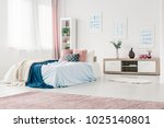 blue bedding on bed in cozy... | Shutterstock . vector #1025140801