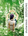 backpacker young woman standing ... | Shutterstock . vector #1025141461