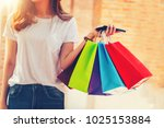 shopping mall. happy woman... | Shutterstock . vector #1025153884