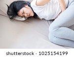 asian woman having painful... | Shutterstock . vector #1025154199