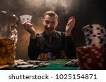 handsome poker player with two... | Shutterstock . vector #1025154871