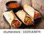 vegetable indian rolls are... | Shutterstock . vector #1025163874
