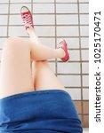 selfie of sneakers. woman... | Shutterstock . vector #1025170471