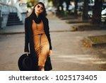 stylish girl walking through...   Shutterstock . vector #1025173405