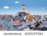man in a mess of laundry | Shutterstock . vector #1025197561
