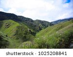 dzukou valley. border of the... | Shutterstock . vector #1025208841