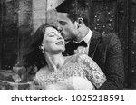 wedding couple is kissing near... | Shutterstock . vector #1025218591