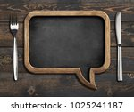 menu blackboard frame on wooden ... | Shutterstock . vector #1025241187