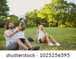 family playing with a ball in... | Shutterstock . vector #1025256595