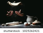 cropped shot of chef throwing... | Shutterstock . vector #1025262421