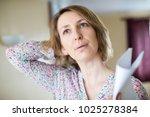 mature woman experiencing hot... | Shutterstock . vector #1025278384