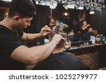 barber shop. master makes... | Shutterstock . vector #1025279977