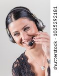 Small photo of Happy and friendly help desk lady, cheerful and amicable, talking to a customer