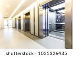 modern steel elevator cabins in ... | Shutterstock . vector #1025326435