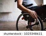 man in wheelchair at home or in ... | Shutterstock . vector #1025348611