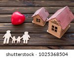figures of a family of wood ... | Shutterstock . vector #1025368504