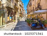 narrow street in the old town... | Shutterstock . vector #1025371561