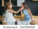 mother and daughter making... | Shutterstock . vector #1025384365