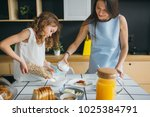 mother and daughter making... | Shutterstock . vector #1025384791