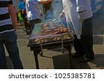 grilling burgers outside... | Shutterstock . vector #1025385781