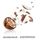 broken coconut with splashes of ... | Shutterstock . vector #1025394535