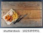 fried fish sticks with sauce... | Shutterstock . vector #1025395951