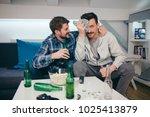 friends watching sport on tv | Shutterstock . vector #1025413879