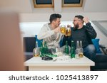 friends watching sport on tv at ... | Shutterstock . vector #1025413897