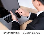 business man touch the mobile... | Shutterstock . vector #1025418739