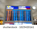 Small photo of Blur background of electronic arrival or departure board in Terminal hall Airport, busy schedule of airline flights for international and domestic which arrive on time and delayed.