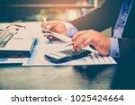 a business man using calculator ... | Shutterstock . vector #1025424664