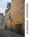 Small photo of Tallinn, Estonia - January 3, 2018: Street of the old town with tower in Tallinn, Estonia