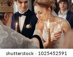 stylish bride and groom... | Shutterstock . vector #1025452591