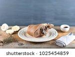 pork leg ham on the plate on a...   Shutterstock . vector #1025454859