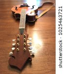 Mandolin On Wood Background
