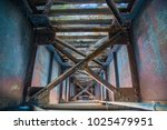 underneath inside railroad... | Shutterstock . vector #1025479951