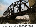 old rusted railroad bridge blue ... | Shutterstock . vector #1025482981