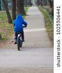 little boy riding a bicycle a... | Shutterstock . vector #1025506441