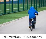 little boy riding a bicycle a... | Shutterstock . vector #1025506459