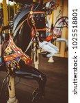Small photo of Retro carousel white / black horse. Old wooden horse carousel. Carousel! Horses on vintage, retro carnival cheerful walk. CloseUp of colorful carousel (roundabout) with horses.vintage photo processing