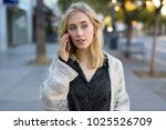 young woman walking talking on... | Shutterstock . vector #1025526709