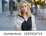 young woman walking talking on... | Shutterstock . vector #1025526715