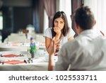 worried woman doubting having... | Shutterstock . vector #1025533711
