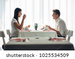 two casual young adults having... | Shutterstock . vector #1025534509