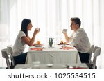 happy couple at restaurant... | Shutterstock . vector #1025534515