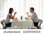 happy couple at restaurant... | Shutterstock . vector #1025534515