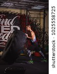 Small photo of Muscular man working out in gym flipping tire, strong male. Strong and fit man. Crossfit concept
